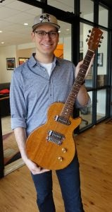 Ben with paul's first guitar