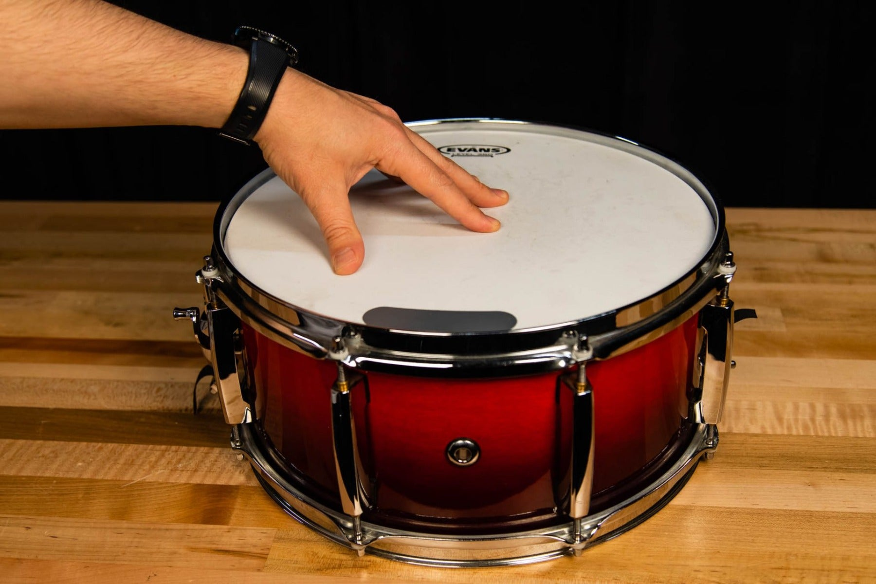 snare drum with hand on drum